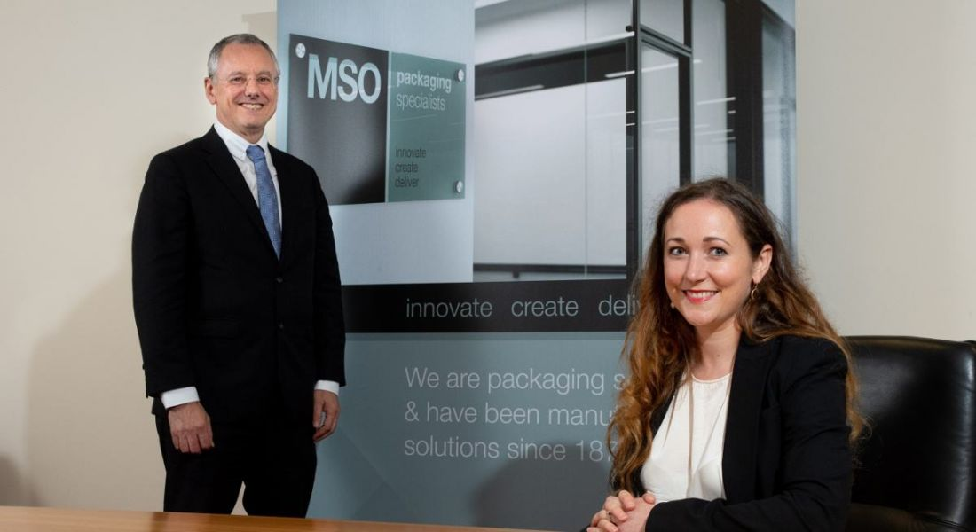 MSO Cleland MD and Invest Northern Ireland CEO are together in an office and smiling into the camera.