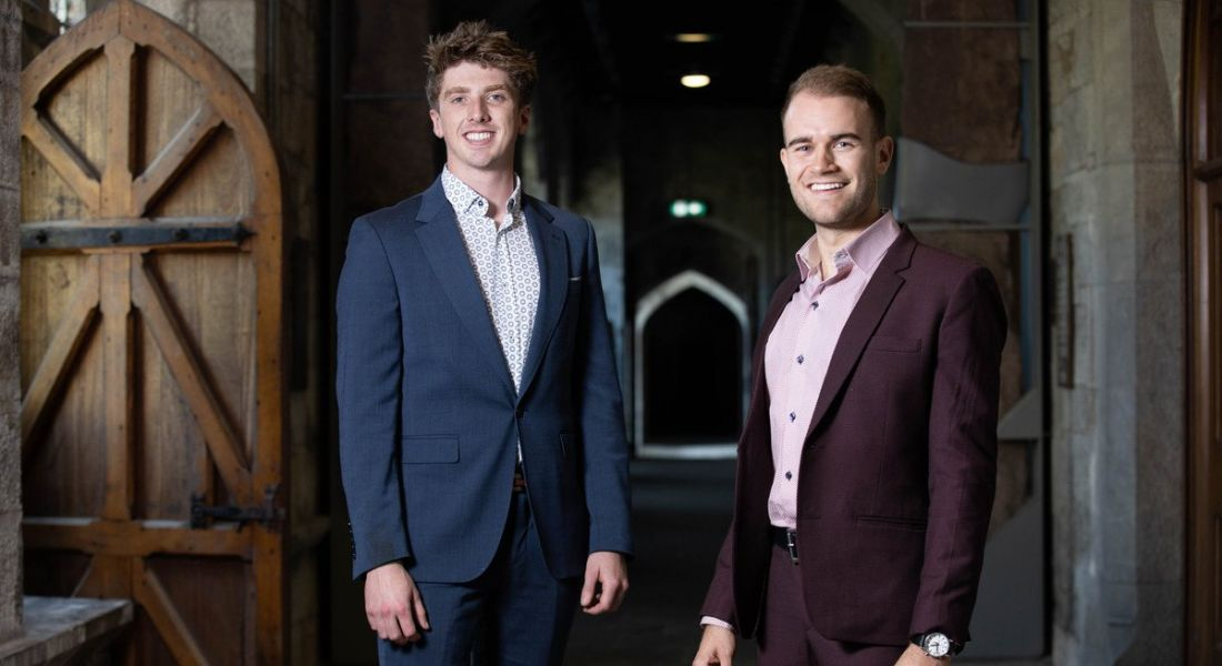 The co-founders of Yooni are standing together in a dark corridor at University College Cork and smiling into the camera.