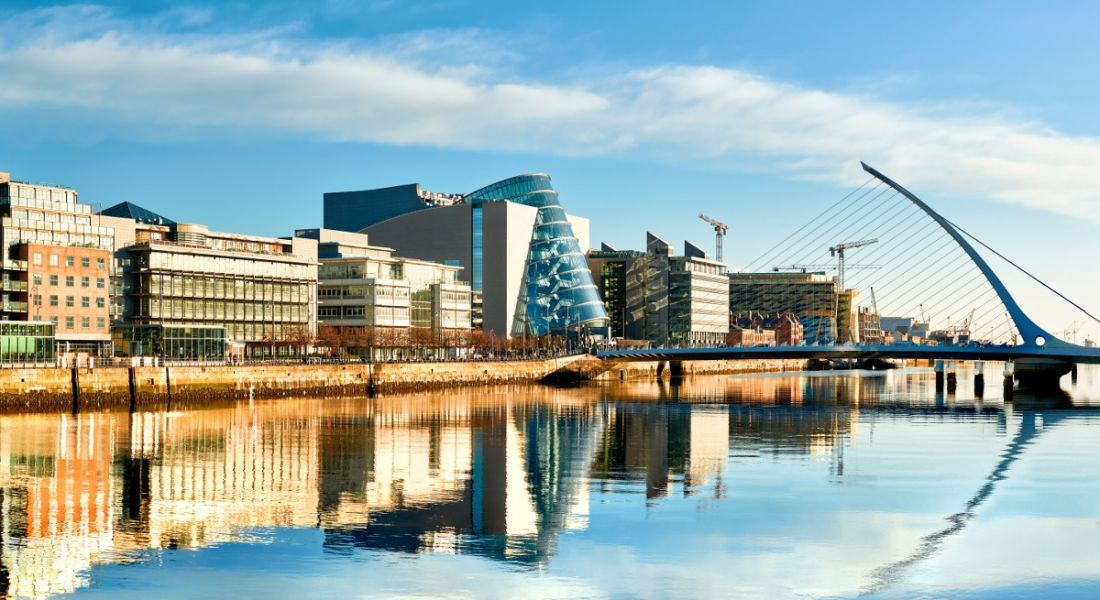 Modern buildings and offices along the River Liffey in Dublin on a bright sunny day.