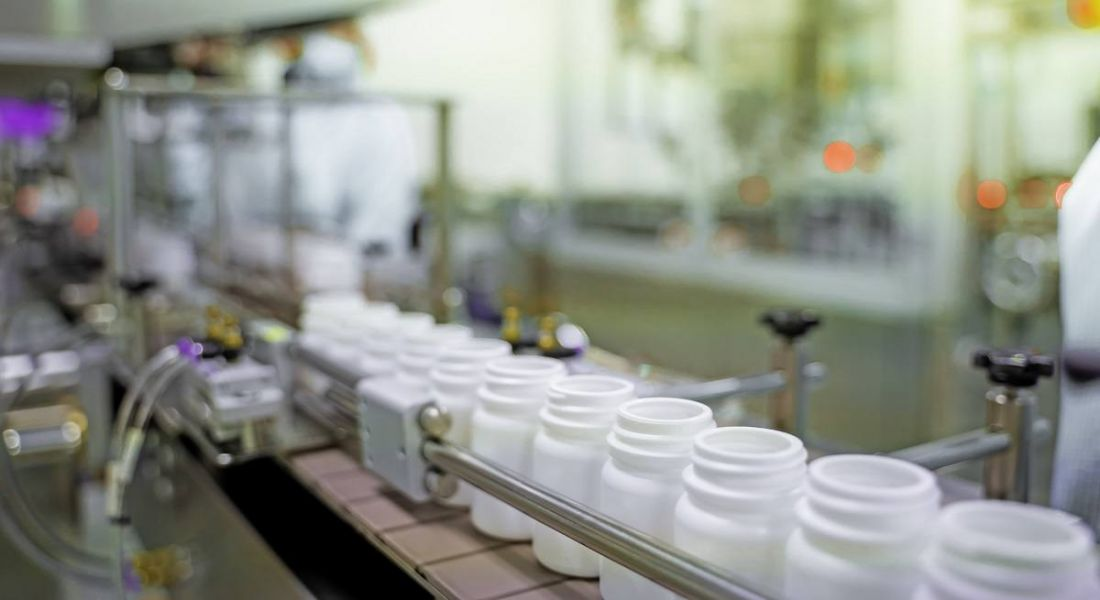 A pharmaceutical manufacturing line with plastic bottles.