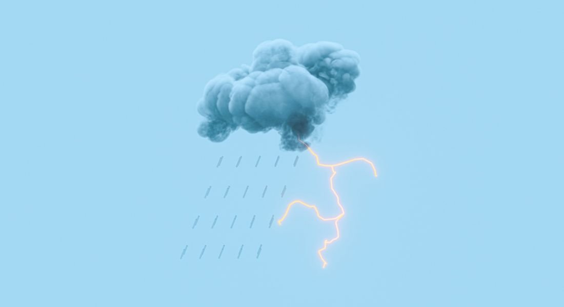 Dark storm cloud with lightning against a blue background.