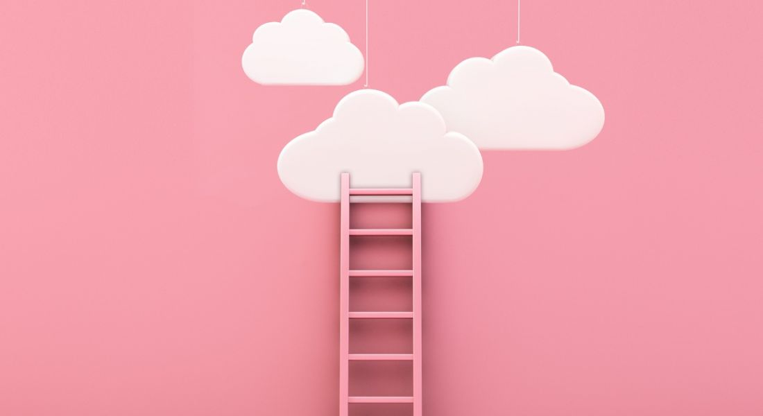 Ladder against a pink wall leading to clouds above it.