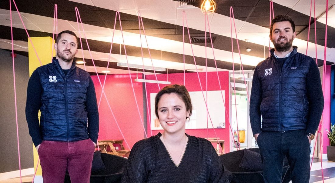 The founders of NoCo are with Huckletree's general manager in a colourful, modern workspace.
