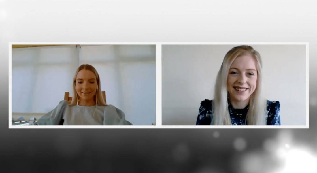 Two young women are smiling while talking to each other about mentorship on a video call.