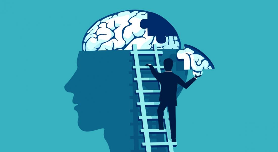 Illustration of a person climbing a ladder to finish a jigsaw puzzle in another figure's brain, symbolising plugging a skills or knowledge gap.