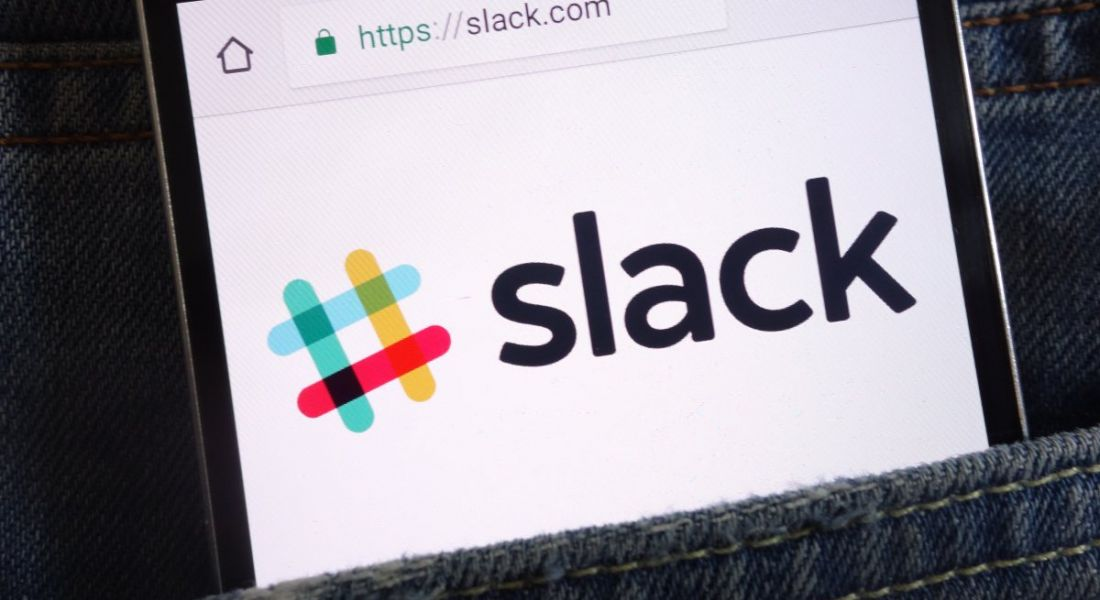 Mobile phone with slack company logo in the pocket of a denim item of clothing.