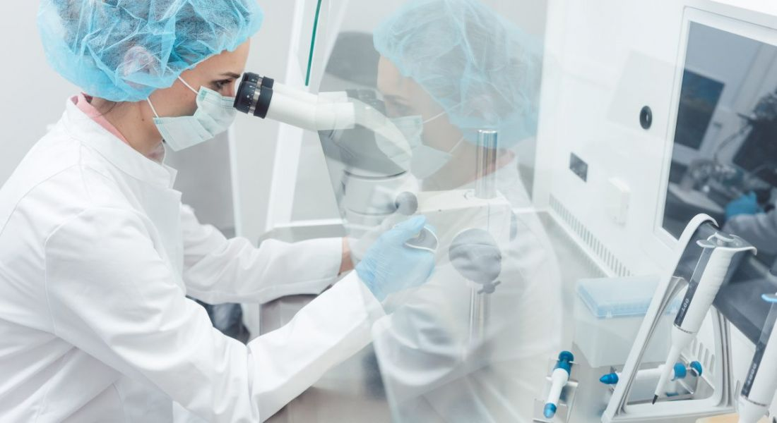 A stock image of a scientist working in a biotech lab.
