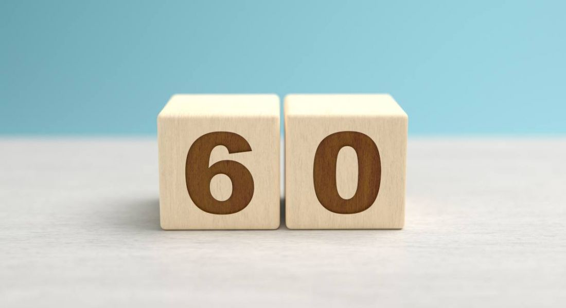 Wooden blocks displaying the number 60.