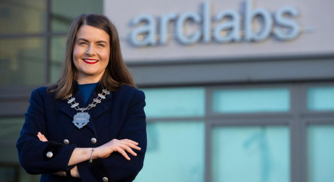 Aisling O'Neill, president of Network Ireland, standing outside the research and innovation centre she manages in Waterford.