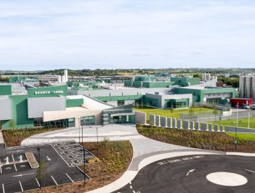 An aerial view of the entire Bausch & Lomb facility in Waterford, which is a large manufacturing site coloured in the company's trademark green.