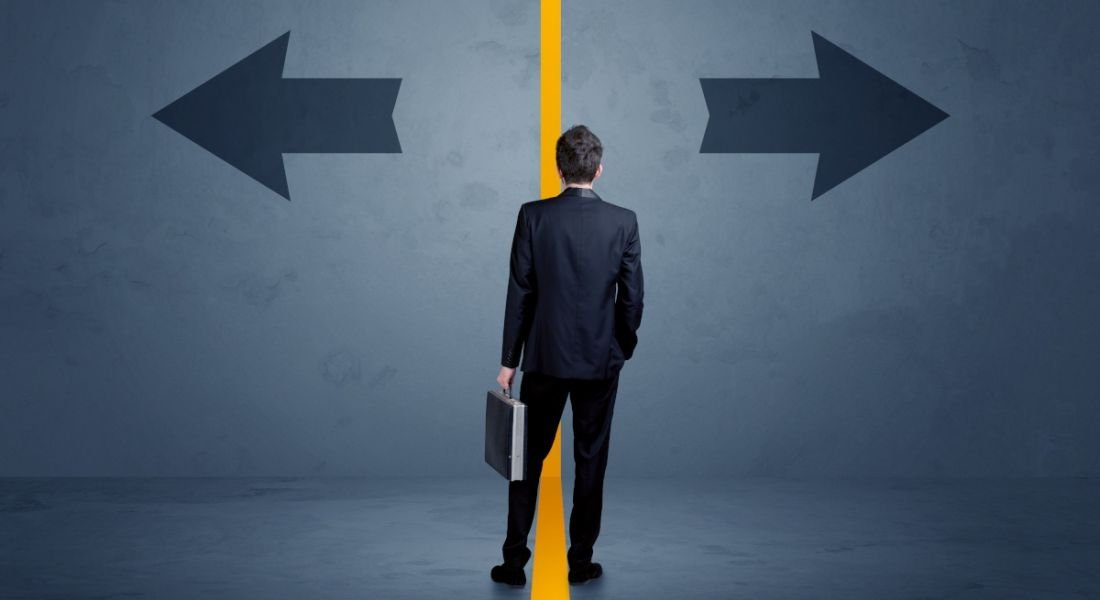 Business person choosing between two options separated by a yellow border arrow concept.