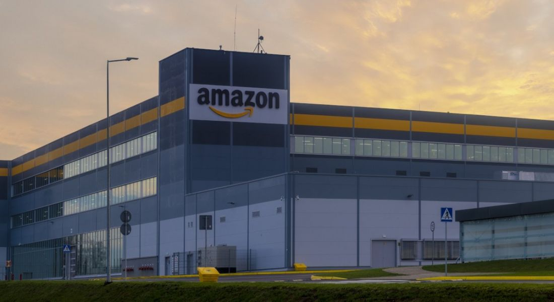 The exterior of one of Amazon's buildings bearing the company's logo.