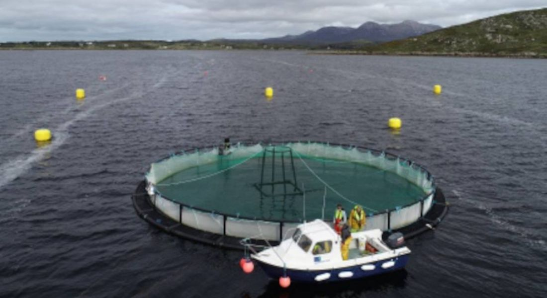 View of Lehanagh Pool site, Connemara Co Galway, showing a boat parked at a fish farm at the Marine Institute's research site.