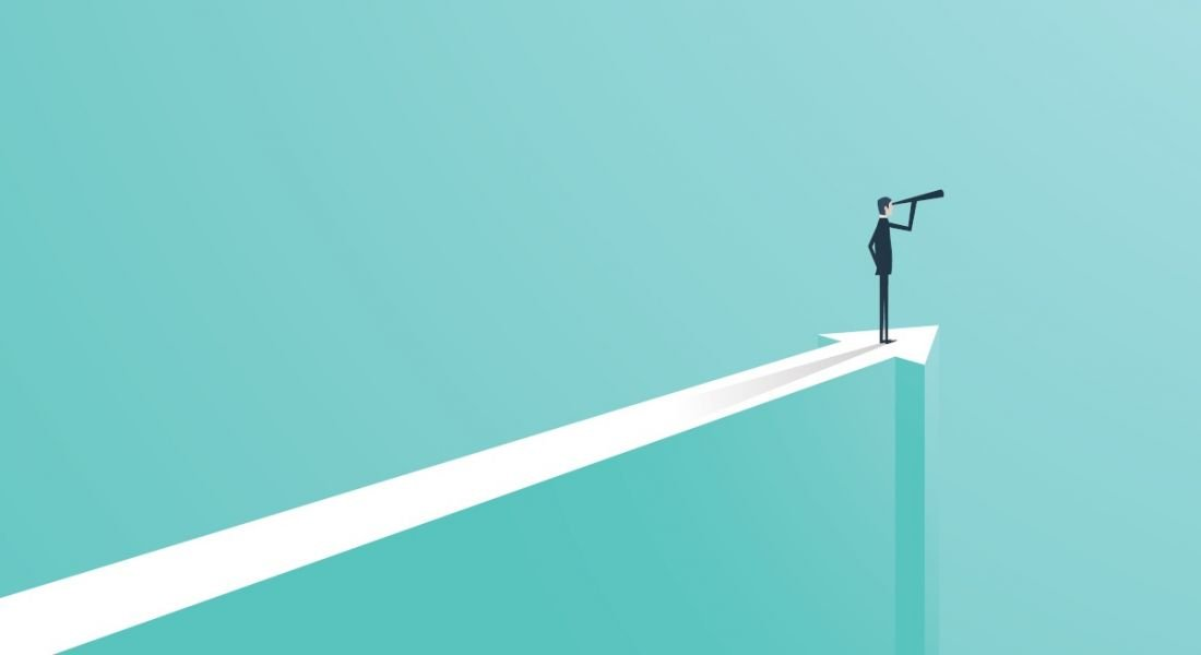 An animated graphic of a businessman standing on a long white arrow looking ahead with a telescope against a light blue background.