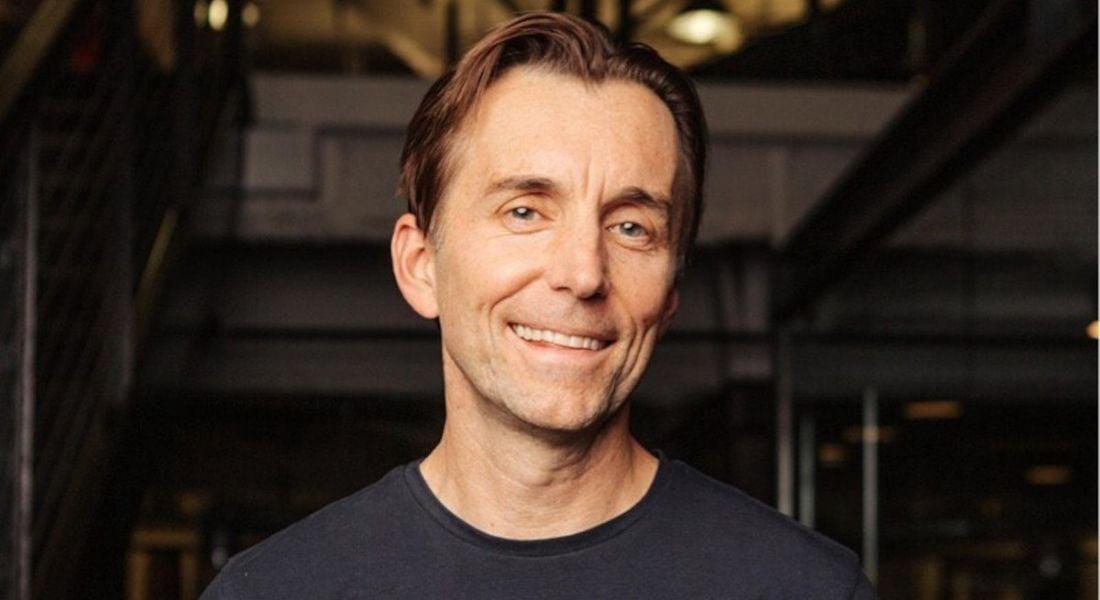 Zig Serafin, CEO of Qualtrics, standing against a dark background.