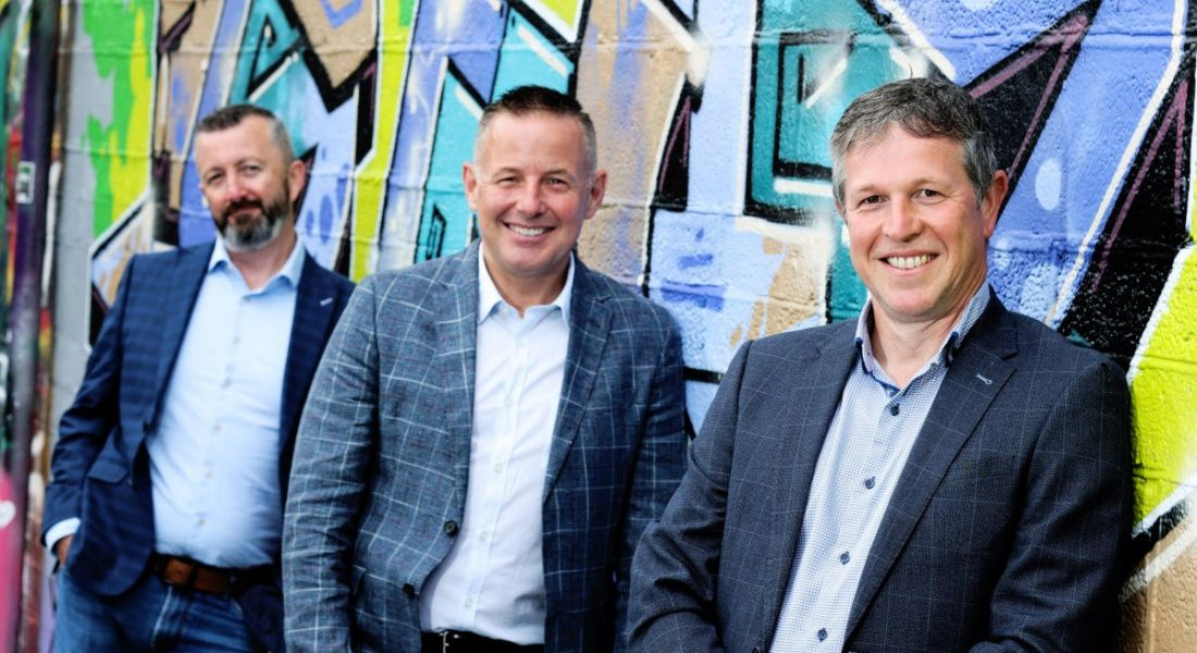 Photo of Ethos co-founders John Coroner, Greg Hayden and Colm Devin leaning against a wall with graffiti on it.