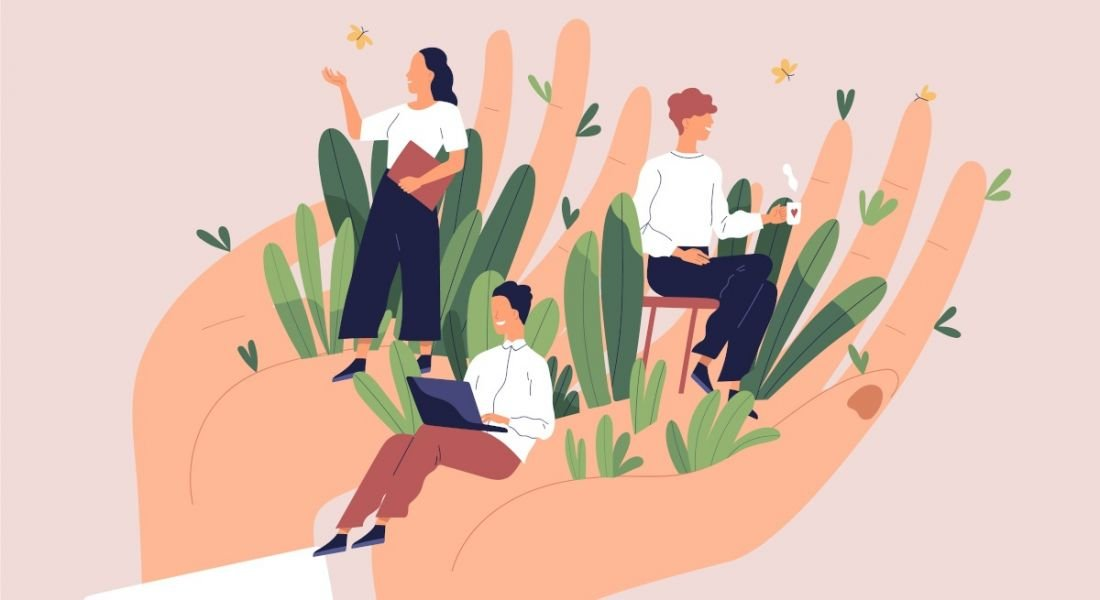 A vector image of a pair of hands cupped, holding three tiny office workers who are surrounded by grass and butterflies, symbolising workplace wellbeing.