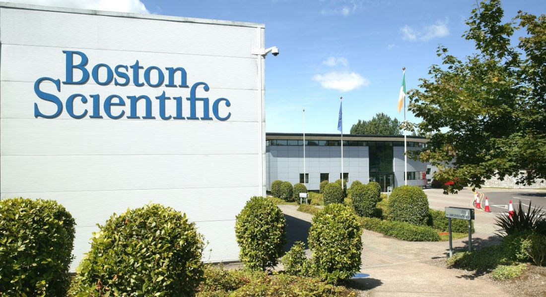 A large building that has Boston Scientific written on the side of it.