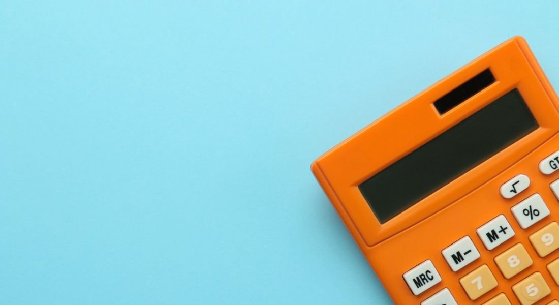 Orange calculator on a bright blue background.