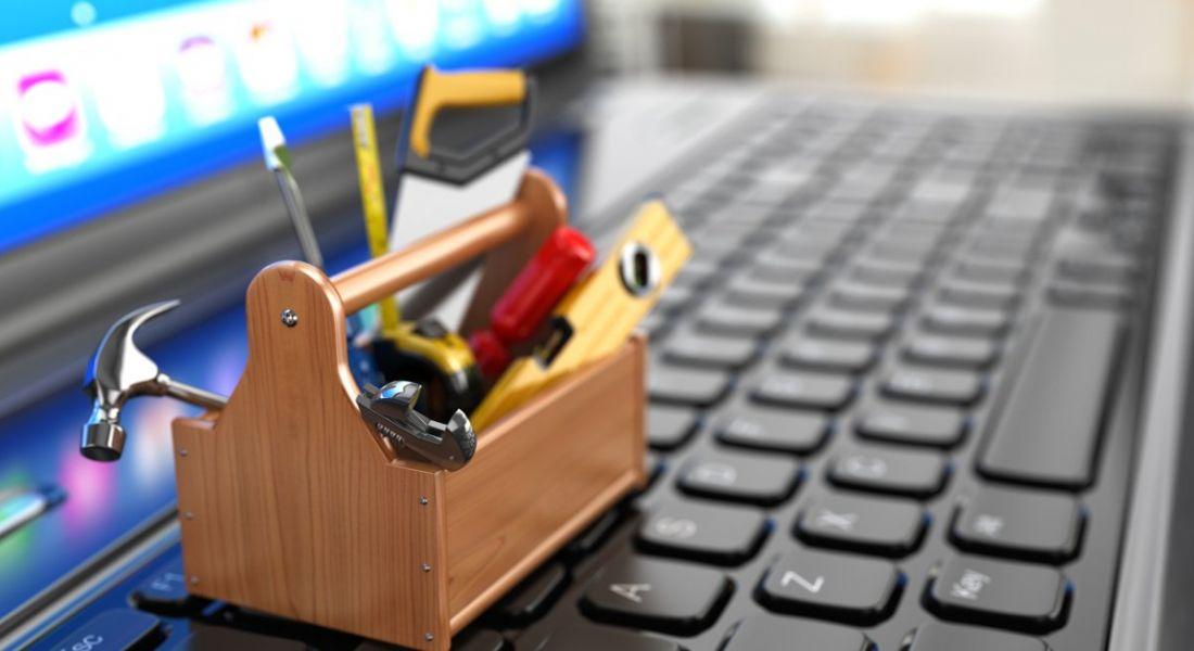 A mini toolbox resting on a computer keyboard.