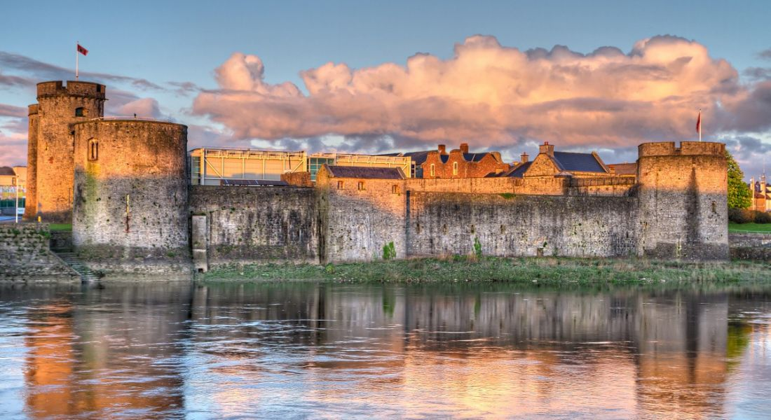 King John Castle in Limerick at sunset from across the water.
