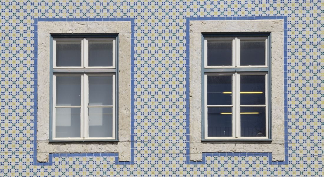 Two windows in a tiled wall.