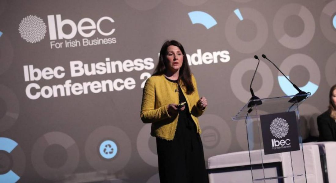 Karen O'Regan of Accenture Ireland is delivering a talk on stage at an IBEC event.
