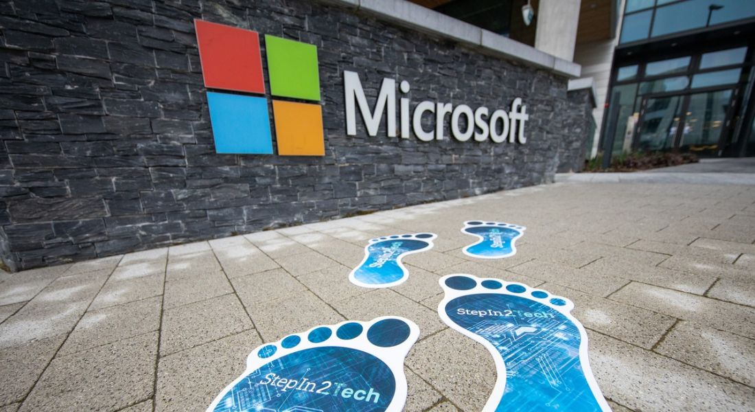 Microsoft StepIn2Tech branded footprints are on the path outside a Microsoft office building.