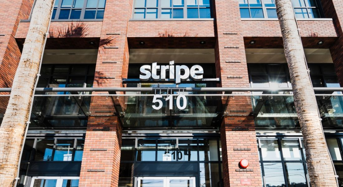 The Stripe logo over the entrance of a red-brick building in San Francisco.
