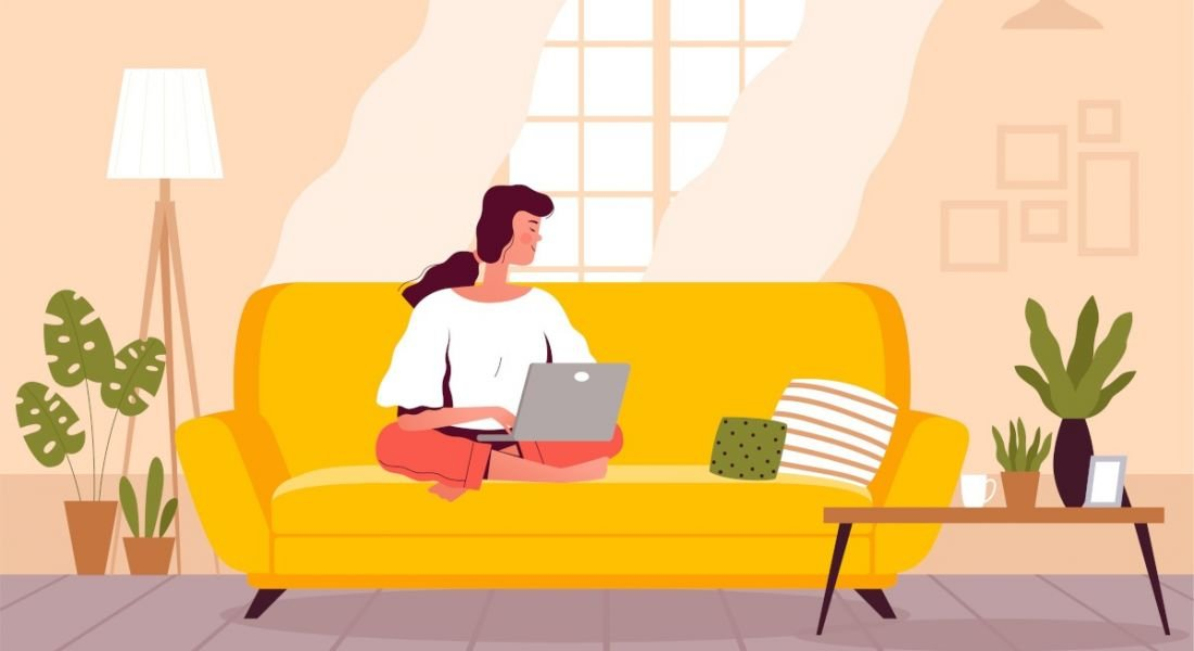 Illustration of a woman staying productive while working from home on a couch in front of a window and beside plants.