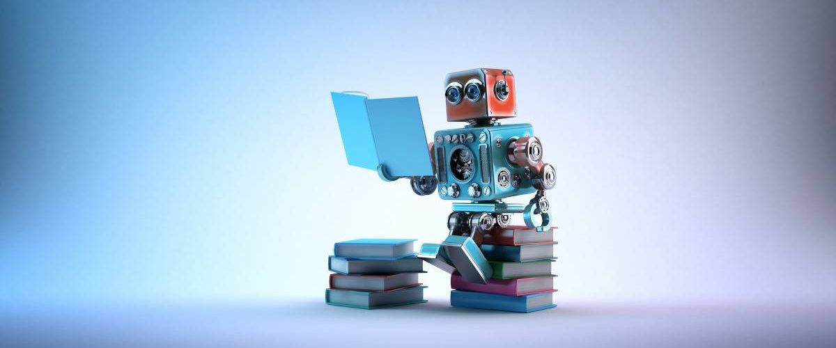 A cute toy robot is sitting on a stack of books and reading.