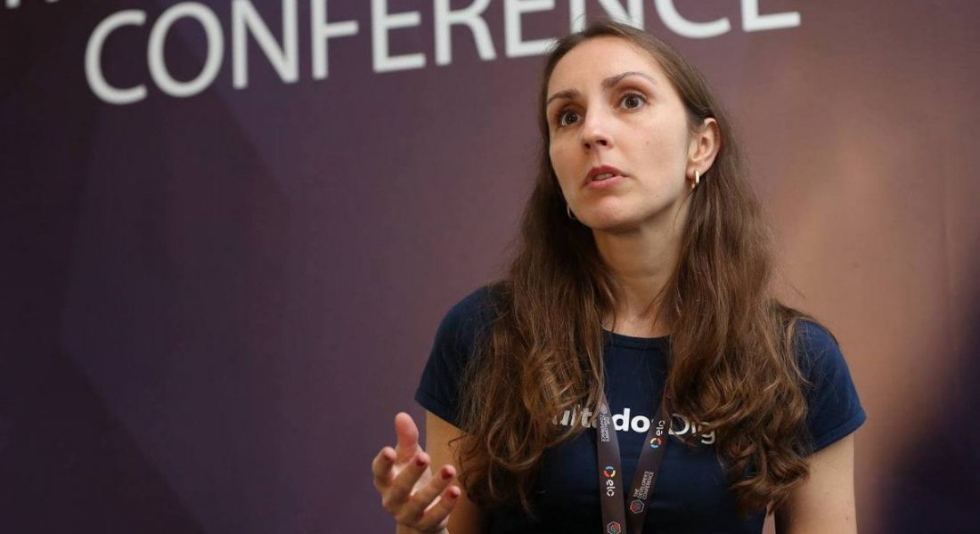 Software developer Karla Maria Garcia conducts a presentation at a developers conference.