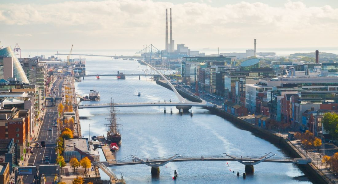 Scenic picture of Dublin city's skyline featuring the Liffey river.