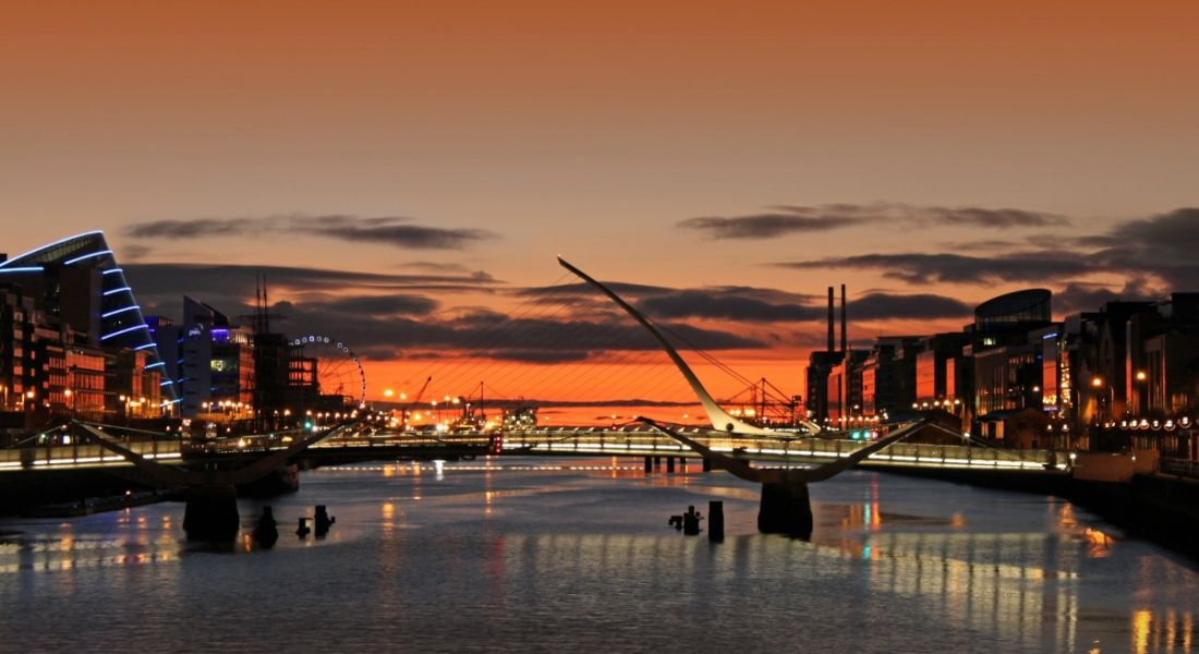 Sunrise over the river Liffey in Dublin, showing offices around the docklands area.