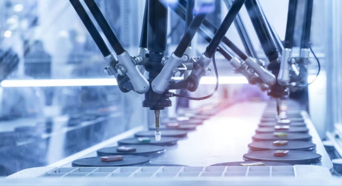 Robotic manufacturing equipment on an assembly line symbolising medtech manufacturing.