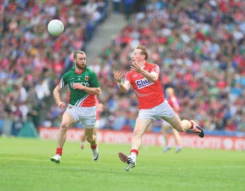 Last game: Corks Damien Cahalane, pictured in action against Mayo in the All-Ireland football quarter-final at Croke Park, will line out with the Rebel hurlers only next season after deciding not to continue his dual role.