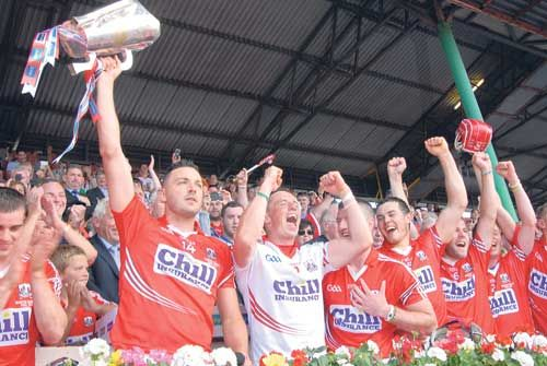 Back at the top: Cork captain Pa Cronin lifts the cup after the Rebels won the 2014 Munster SHC final after victory over Limerick in Páirc Uí Chaoimh.