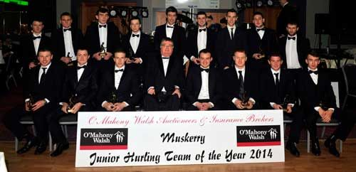 The Muskerry Junior Hurling Team of 2014 pictured with JJ Long, Muskerry GAA Chairman, and Barry Walsh, of sponsors OMahony, Walsh Auctioneers and Insurance Brokers.