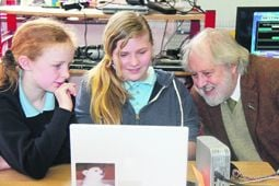 David Puttnam talks technology with Cappabue pupils Hannah Campbell and Bonnie Dale