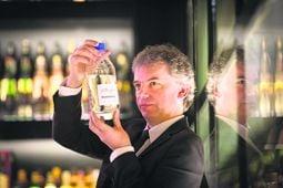 Prof Tangney surveying a bottle of biobutanol