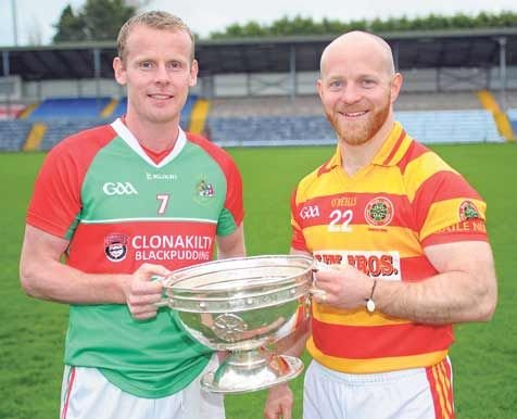 Derby date: First-round opponents Donal Lyons (Clonakilty) and Martin OBrien (Newcestown) pictured with the Andy Scannell Cup at the official launch of the Cork SFC in Páirc Uí Rinn.