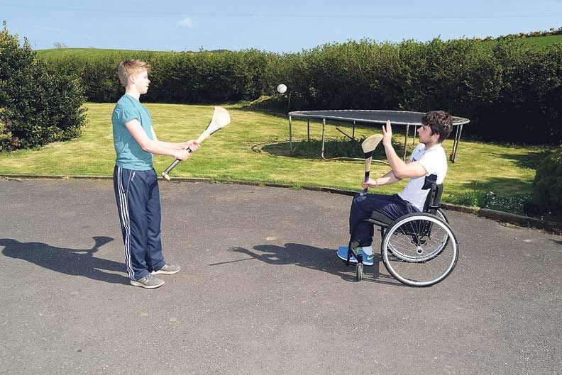 Home comforts: Jamie Wall and his younger brother Philip enjoyed a puckaround at home in Kilbrittain.