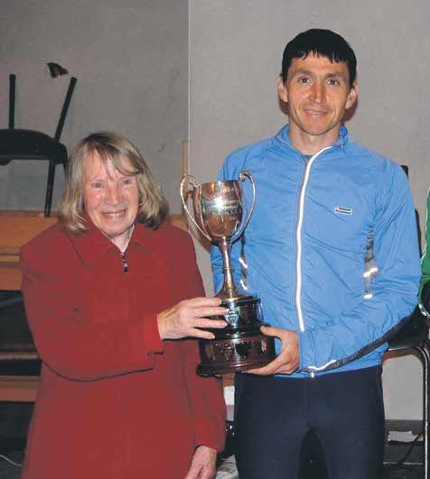 Presentation: Alan OShea, winner of the Midleton five-mile road race, receives the Joe Hourigan Memorial Trophy from Angela Hourigan.