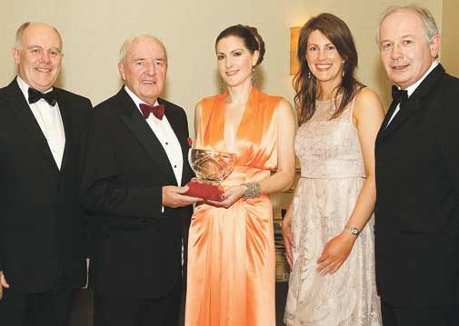 Happier times: Bill OHerlihy presenting the Celtic Ross West Cork Sports Star of the Year 2012 award to Ruth Anne Sheahan of Leap at the gala banquet in Rosscarbery, where he proved a popular special guest.
