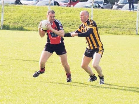 Former Clare senior footballer Noel Griffin (Kilbrittain) puts Shanballymores Jerome Fitzgerald under pressure during last Saturdays county junior B football championship game in Ballygarvan.