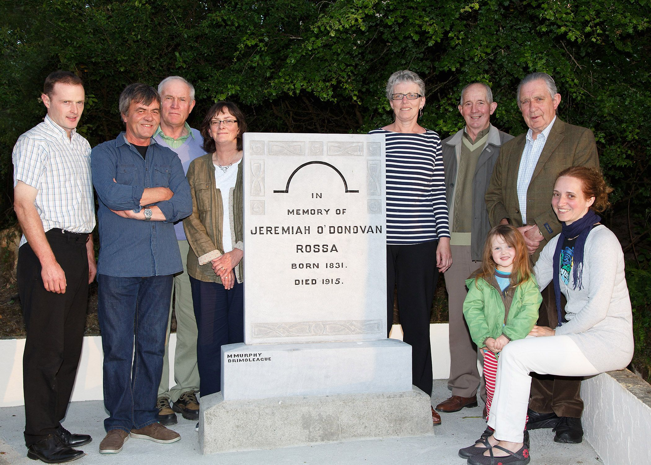 The committee at the newly restored monument