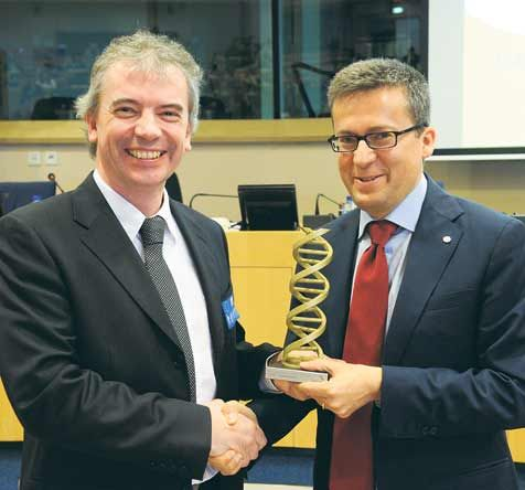 Professor Martin Tangney, originally from Macroom, being presented with the prestigious innovation award and a cheque for ¬10,000 at the European Parliament by Carlos Moedas, the EU Commissioner for Research, Science and Innovation.