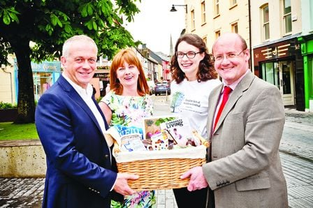 Noel Lawlor (left) and Sinead OCrowley, Clonakilty Chamber of Commerce together with Random Acts of Kindness (RAOK) Festival organiser Theresa OLeary, present a gift of the towns produce and crafts to Jason Field of Skibbereen and District Chamber to m