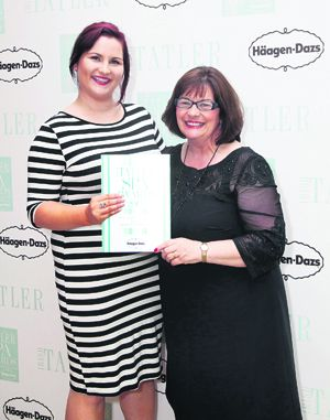 Lucy Williams, assistant spa manager, and Carol Rea, spa receptionist, receiving their award for Best Service for The Island Spa at Inchydoney Island Lodge at the Irish Tatler Spa Awards 2015.