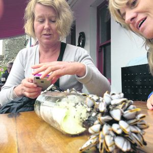 Bridget Healy and Philomena Flynn examine the bottle they found on Long Strand.